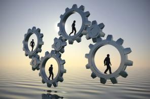 Gears of teamwork at sea at dawn